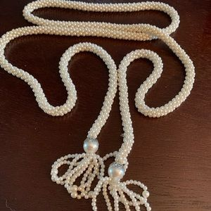 Pearl beads with loops on the end of a necklace